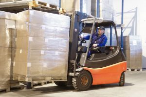Forklift loader worker driver at warehouse
